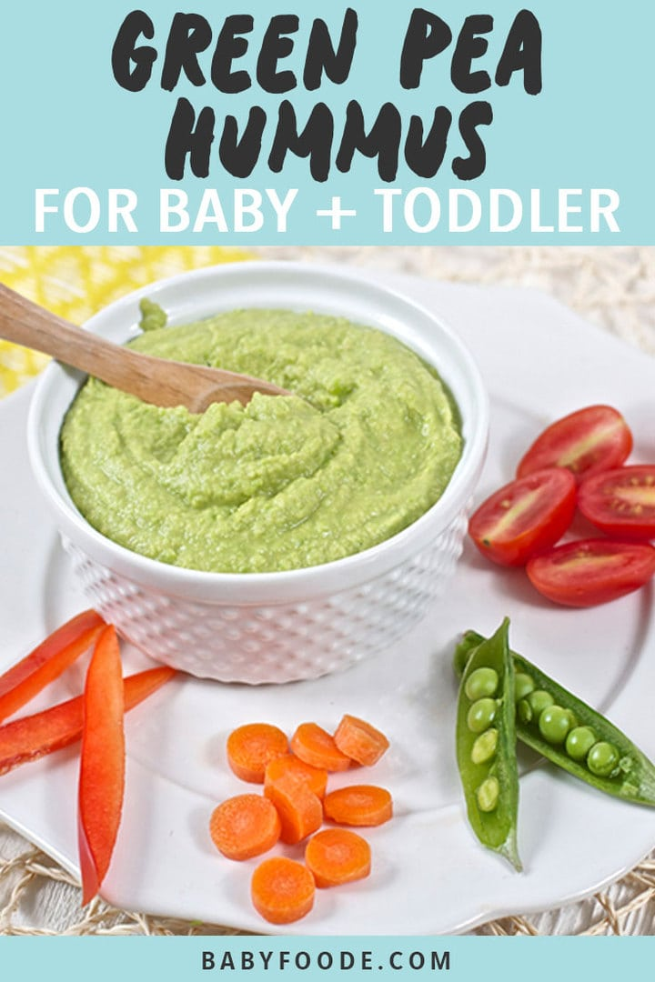 Graphic for Post - Green Pea Hummus for Baby + Toddler. Image is of a small bowl filled with hummus on a plate with chopped veggies.