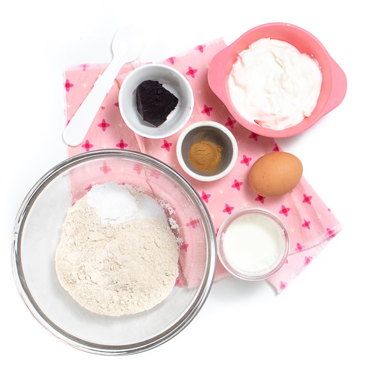 Spread of ingredients for beet pink pancakes on a pink napkin.