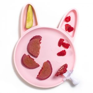 Pink bunny plate for baby or toddler filled with pink pancakes, raspberries and avocado.