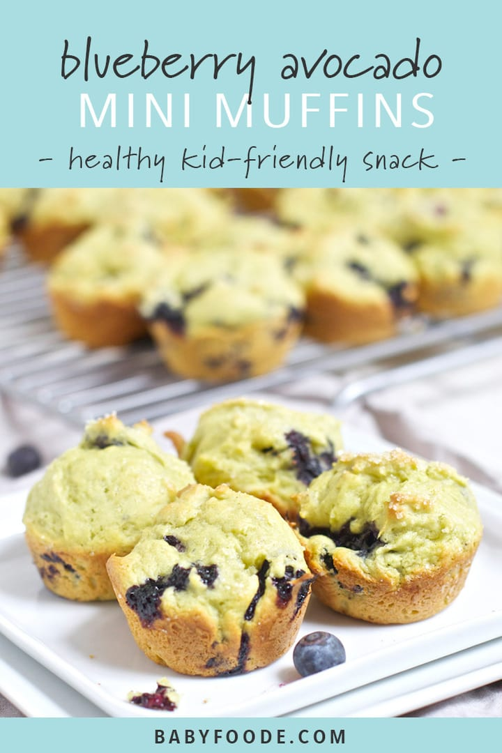 Four avocado and blueberry mini muffins on a plate with additional muffins on a cooling rack in the background.