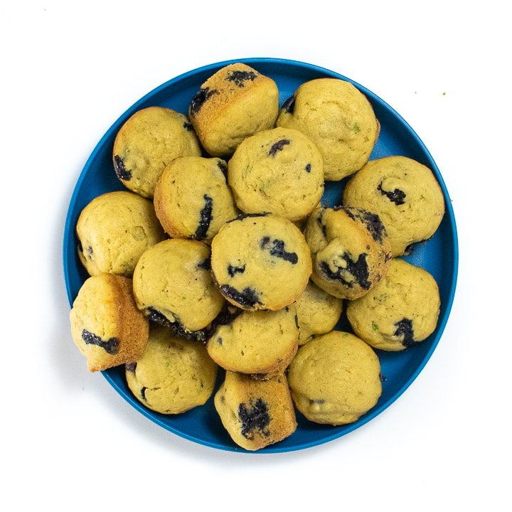 Blue kids plate with mini muffins on it.