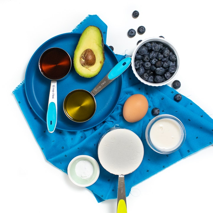 Spread of ingredients for blueberry avocado muffins.