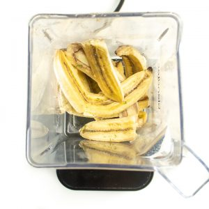 Roasted bananas and rosemary in a blender ready to get pureed into baby food.