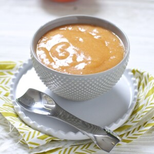 Small gray bowl filled with homemade baby food puree.