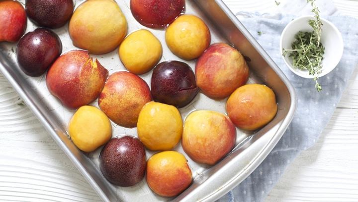 Stone fruit inside of a baking dish.
