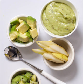 spread of food in small bowls and a smooth and creamy puree for baby.