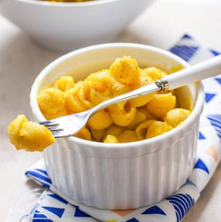 Small white bowl filled with healthy butternut squash Mac and cheese for toddler and kids.