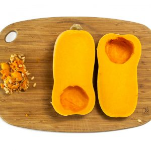 A butternut squash cut in half and deseeded.