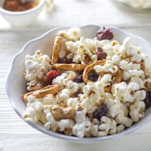 A bowl of kid friendly popcorn trail mix.
