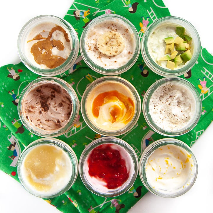 9 small jars of yogurts with fun mix-ins (sugar free).