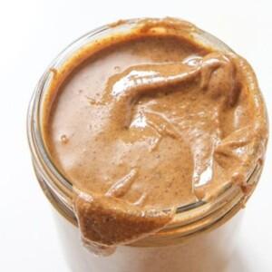 Almond vanilla butter in a glass jar.