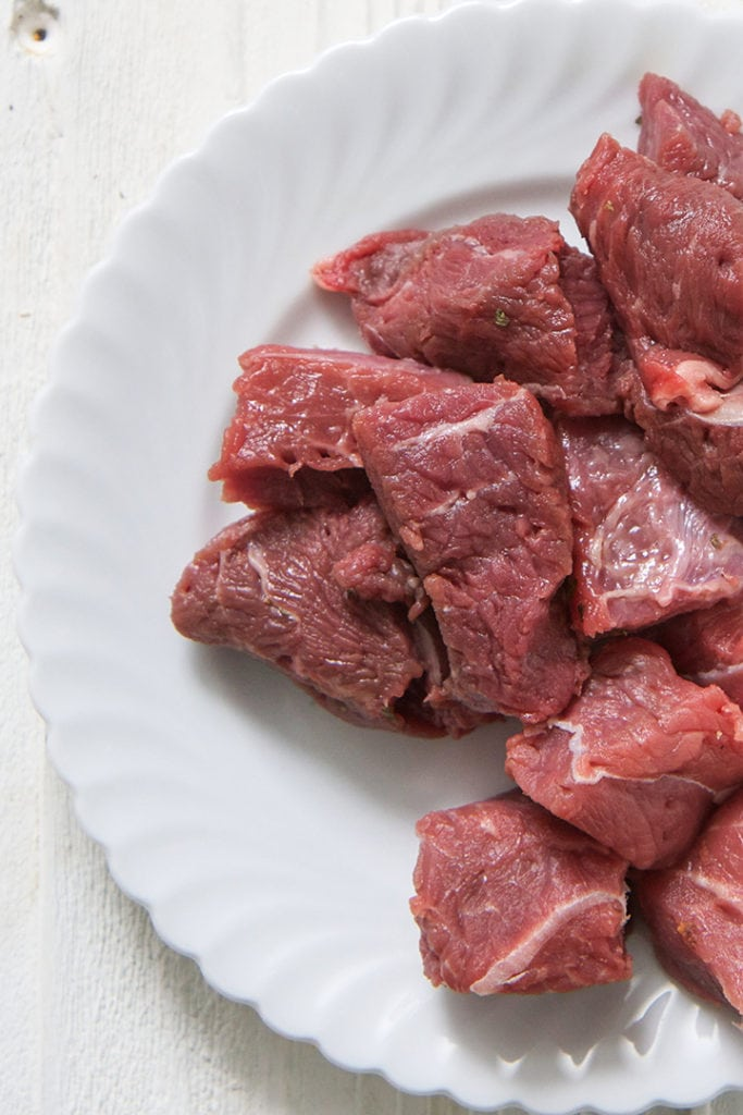 Beef on a white plate.