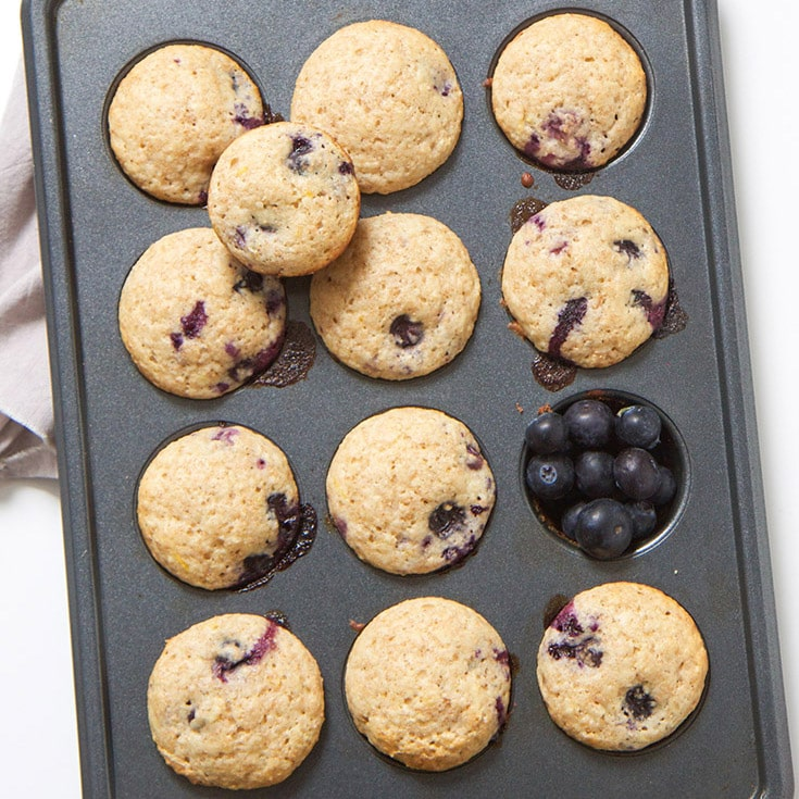 Kid and toddler friendly lemon blueberry muffins in a muffin tin.