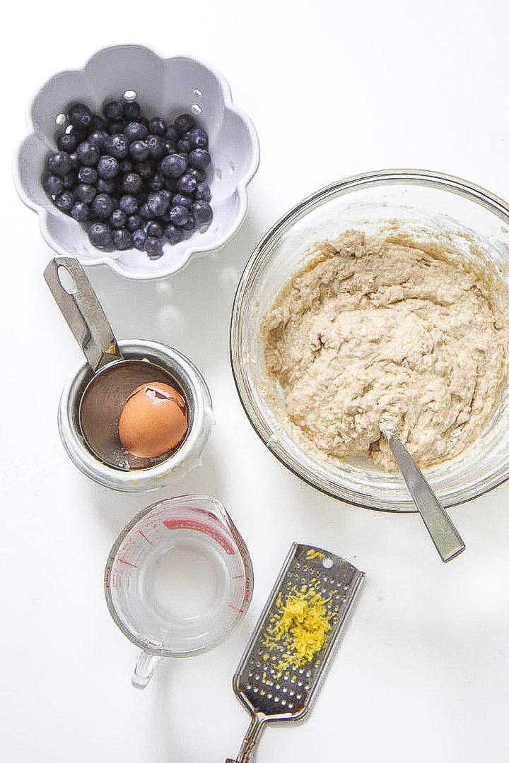 ingredients being used to make toddler blueberry muffins.