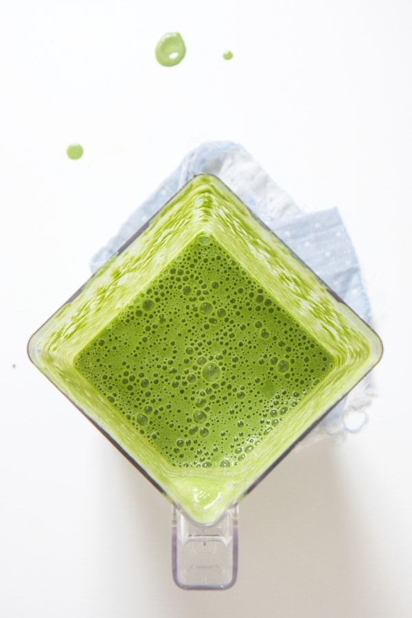 Toddler green smoothie in a blender.