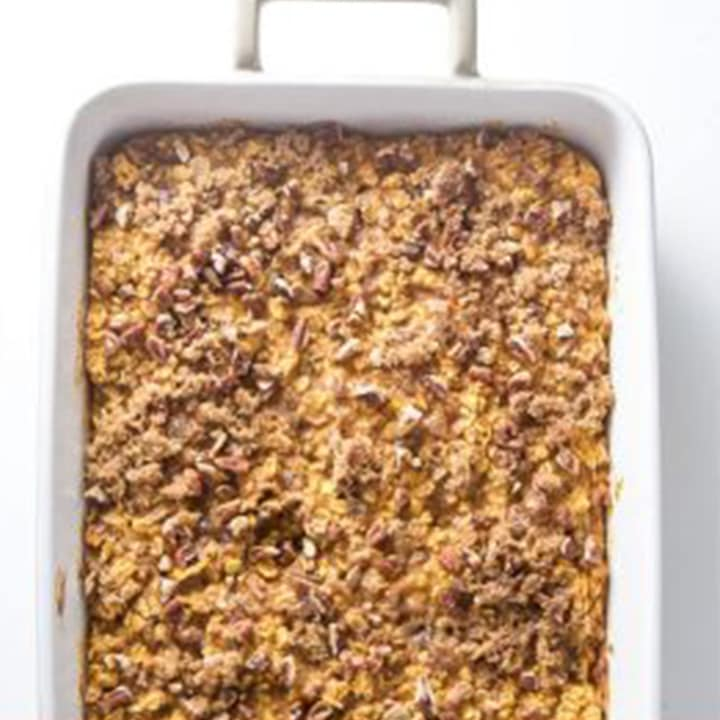 Baked pumpkin oatmeal in a white baking dish.