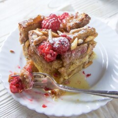 Raspberry French toast for the entire family on a small white plate.