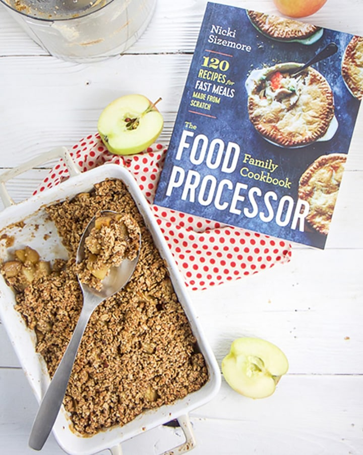 Apple Crisp dessert next to the book the recipe is in.
