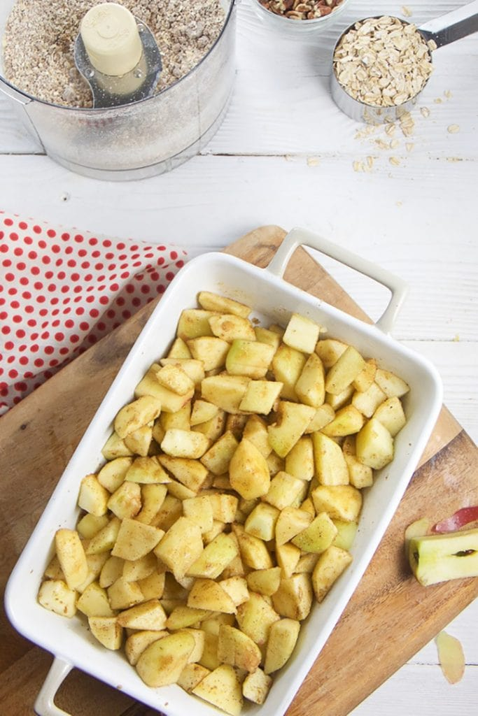 Baking dish is full of spiced apples.