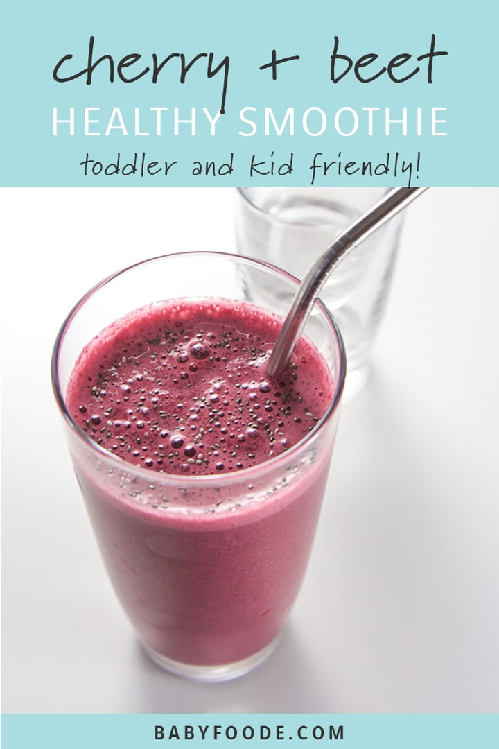 Cherry and beet toddler smoothie in a glass with a metal straw.