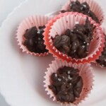 Cherry almond clusters in red cupcake papers.