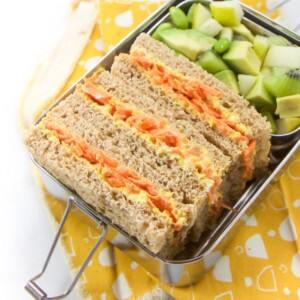 Kid friendly vegetarian sandwich with carrots and beets in a metal lunchbox.
