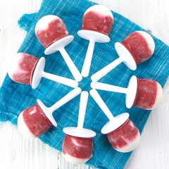 popsicles fanned out on a blue napkin.