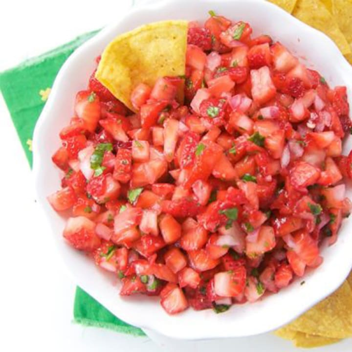 Strawberry salsa in a white bowl.