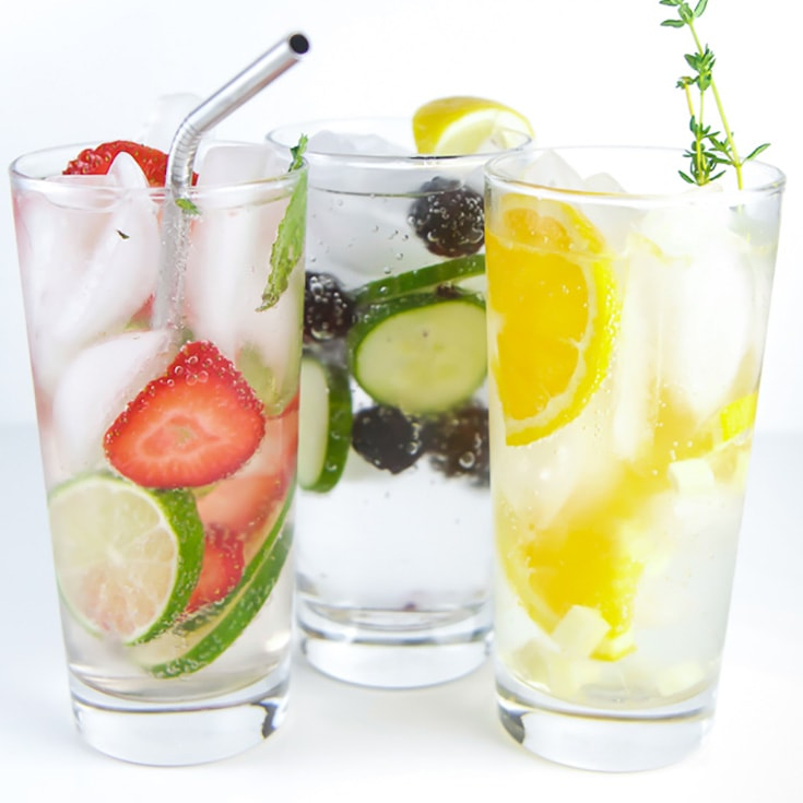 Three glasses of fruit infused water for kids and toddlers.