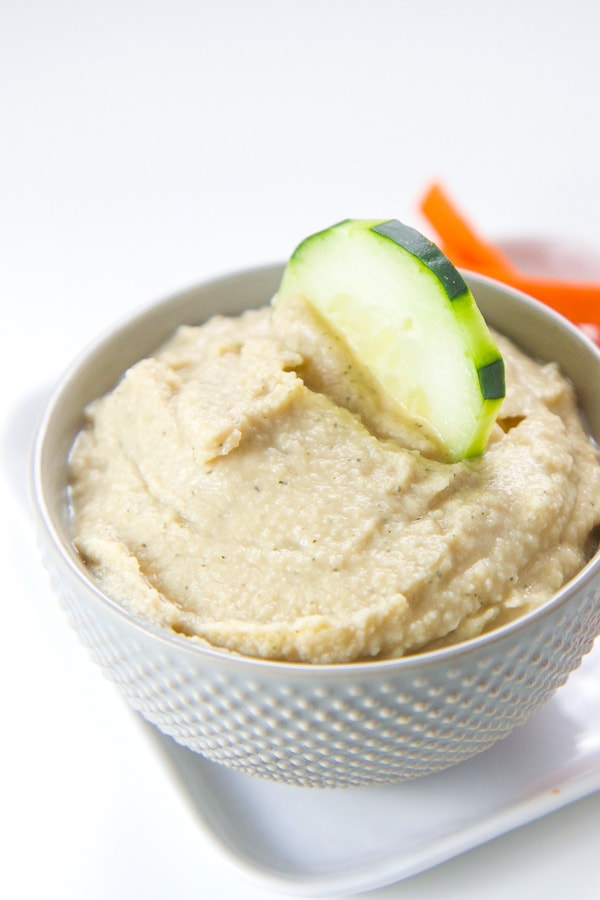 Healthy ranch hummus yogurt dip for kids and toddlers in a white bowl.