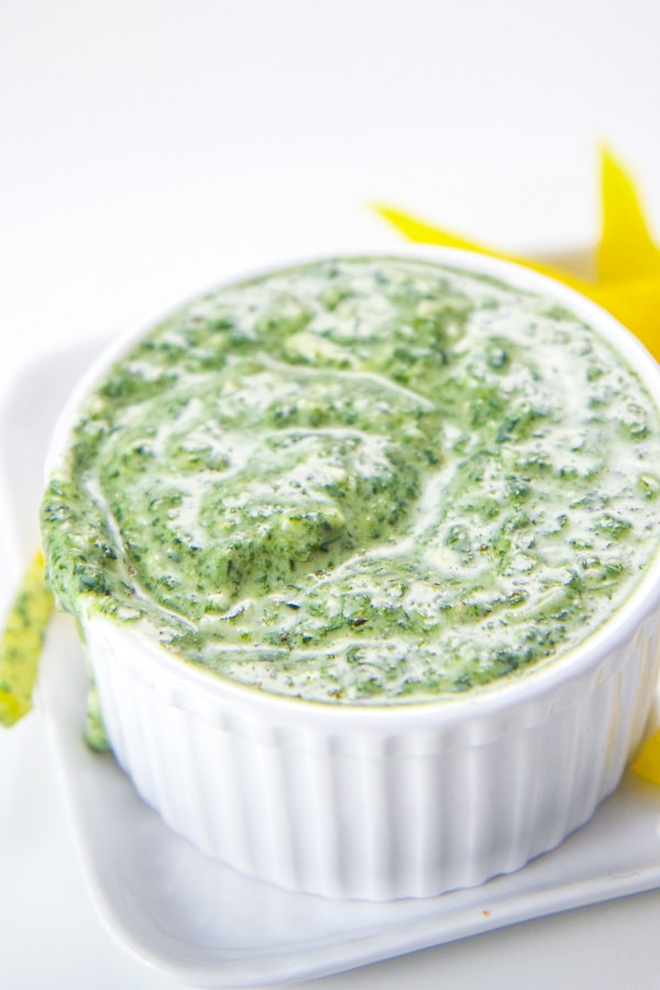 Healthy spinach basil yogurt dip for kids and toddlers in a white bowl.
