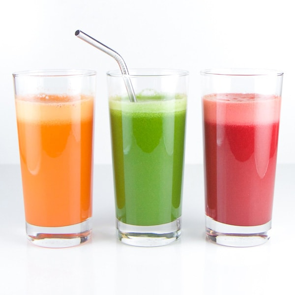 Three colorful and kid friendly immunity boosting juices on a white background.