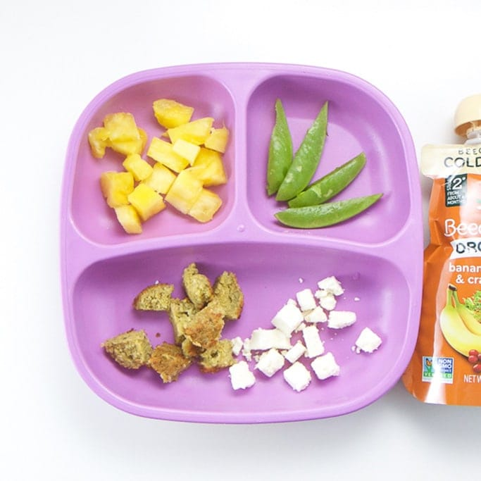 A healthy lunch for a toddler on a purple plate.
