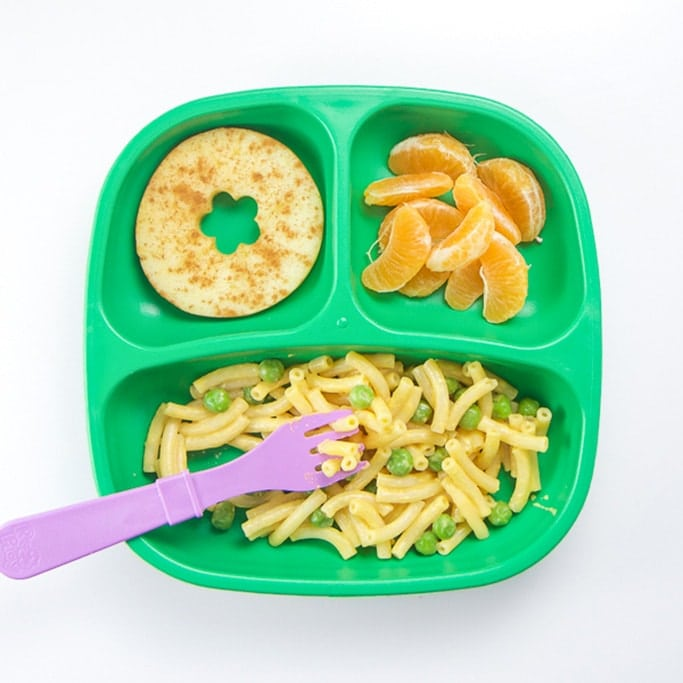 A healthy toddler meal on a green plate.