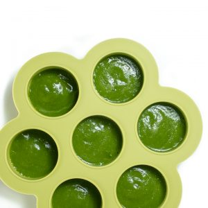 Green bean puree in a freezer container.
