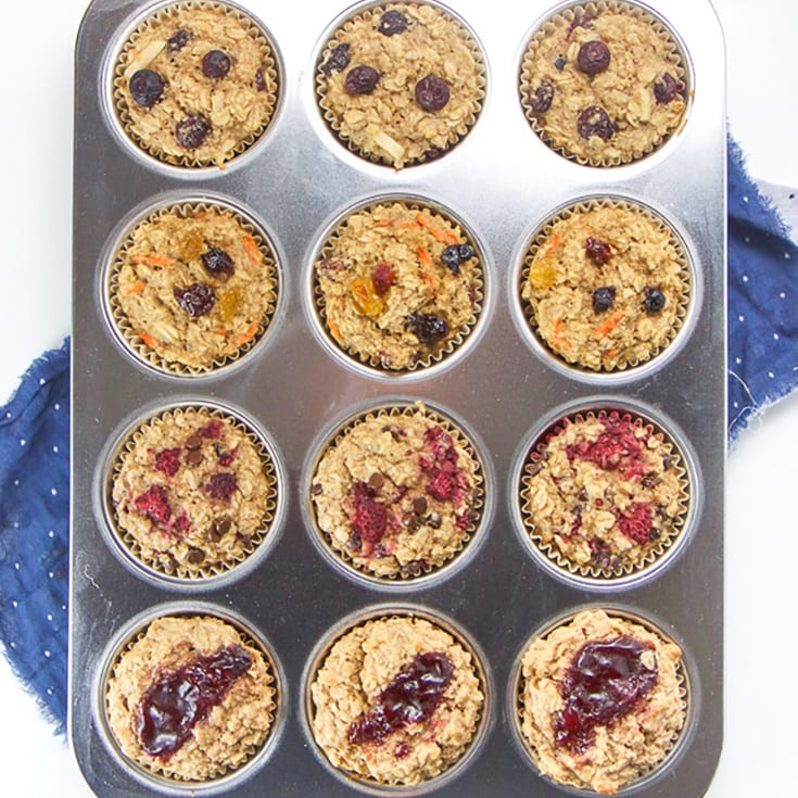 Four varieties of toddler breakfast oat cups in a muffin tin.