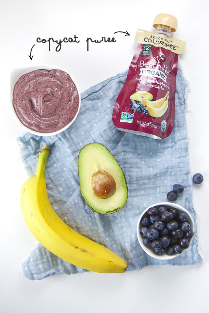 Spread of store bought baby food pouch almong with homemade baby food puree, banana, avocado and blueberries.