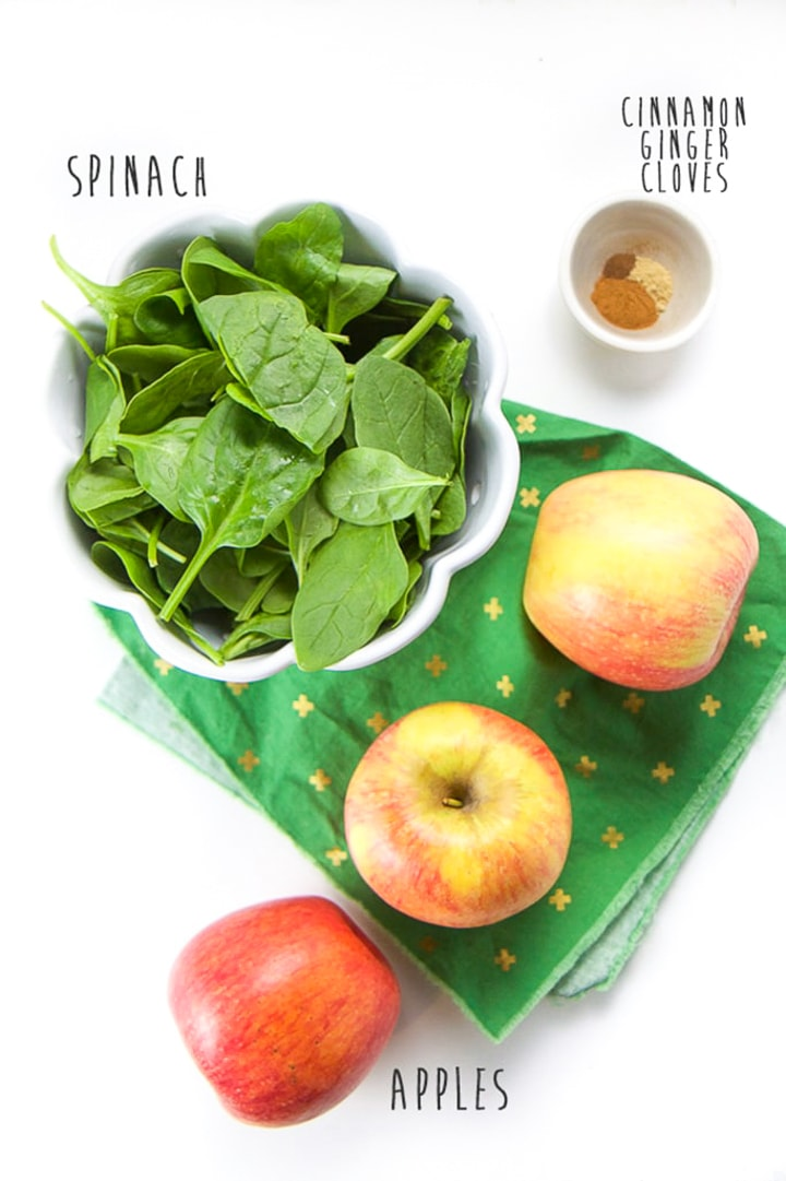 Spread of ingredients for recipe - apples, spinach and spices.