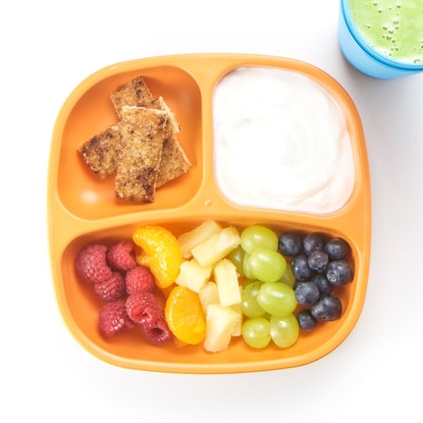 Toddler plate with cut fruit and yogurt dip