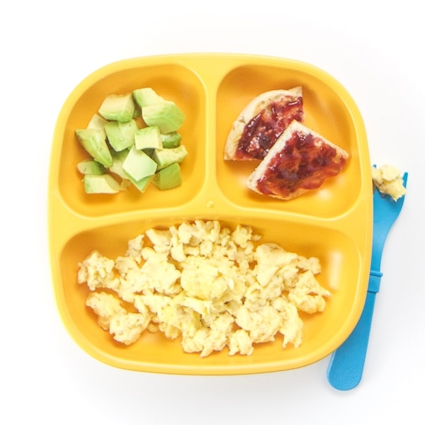 toddler breakfast plate filled with hidden veggie scrambled eggs.