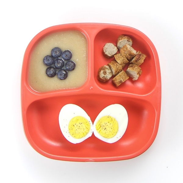 Toddler breakfast idea with eggs, sausage and applesauce.