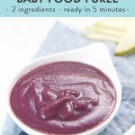 Pear and blueberry baby food puree in a small white bowl.