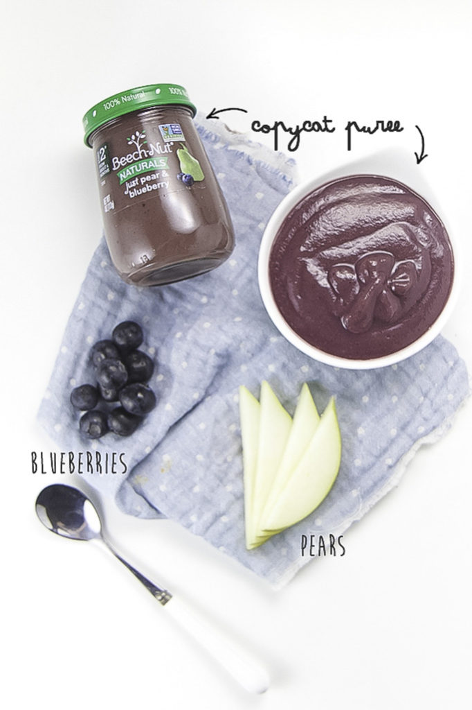 Layout of small bowl of pear blueberry baby food puree with chopped pears, blueberries and a jar of store bought baby food puree.