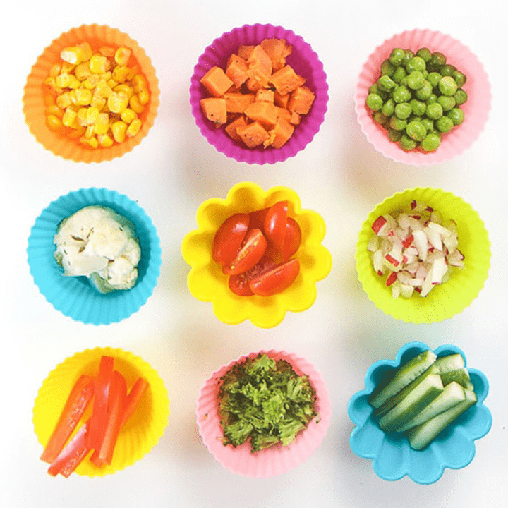 9 small baby bowls filled with small finger foods for baby.
