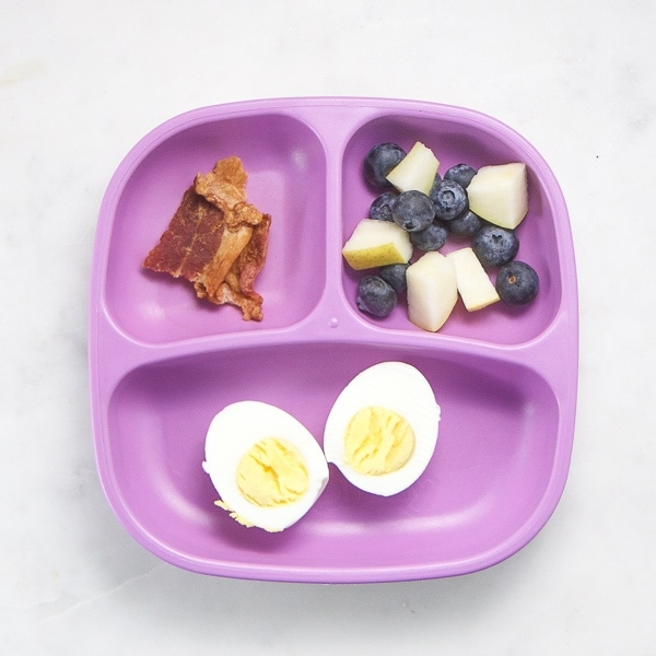 toddler plate filled with breakfast foods