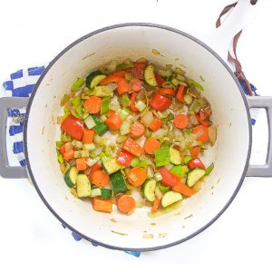 Cooked veggies in a saucepan.
