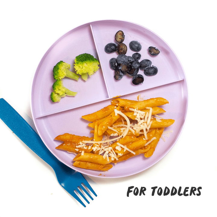 Green plate with hidden veggie pasta sauce made into a meal for toddlers to enjoy.