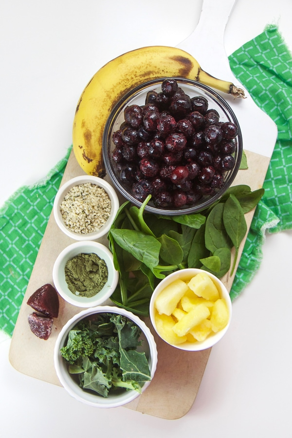The ingredients for a protein power packed kid friendly smoothie arranged on a white background.