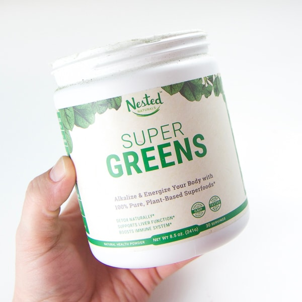 A container of Super Greens plant based supplement for making smoothies.