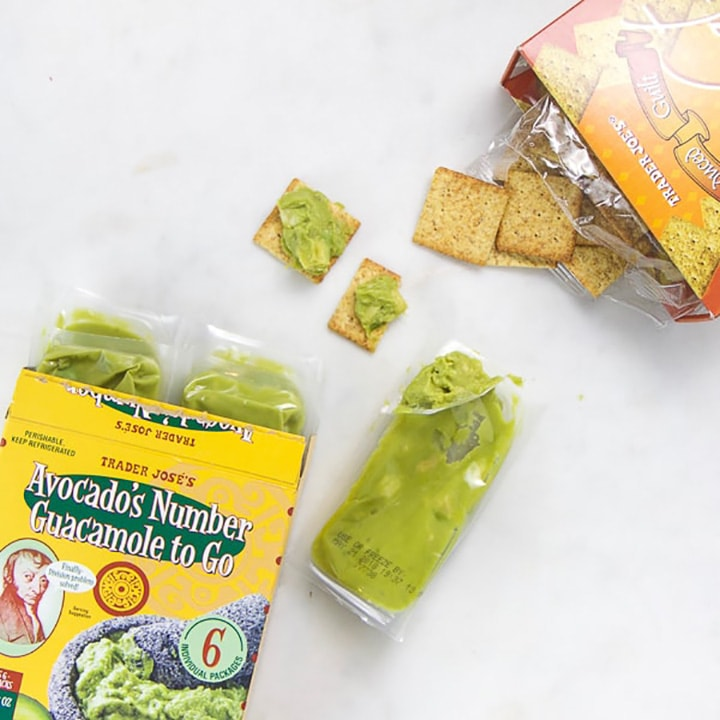 Toddler snack of avocado and crackers.
